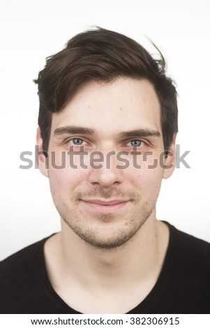 Cute caucasian young adult, in 20s, face close up portrait. White background. Shallow depth of field. - stock photo