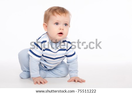 Cute charming baby sitting on the floor - stock photo