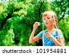 Cute cheerful girl having fun outdoors. - stock photo