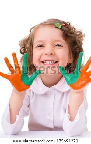 cute cheerful girl showing her hands painted in bright colors, isolated over white