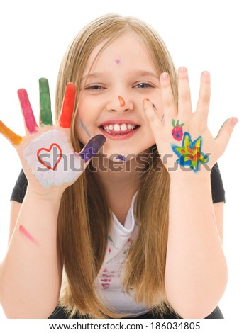 cute cheerful girl showing her hands painted in bright colors, isolated over white - stock photo