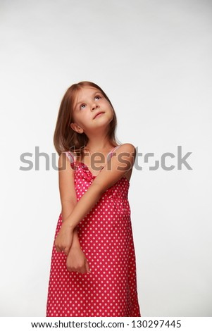Cute cheerful girl with long blond hair on white background - stock photo
