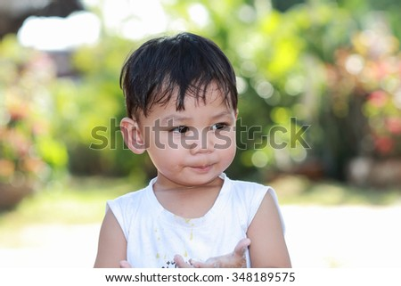 Cute cheerful kids playing outdoors . - stock photo