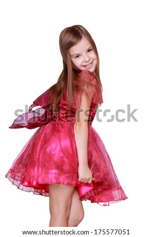 Cute cheerful little girl with beautiful hair wearing a red dress/Studio image of adorable little girl waring fancy dress as a butterfly on Holiday theme
