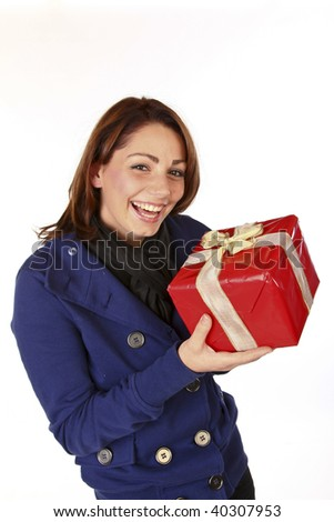 Cute Cheerful Young Woman With Her Christmas Present