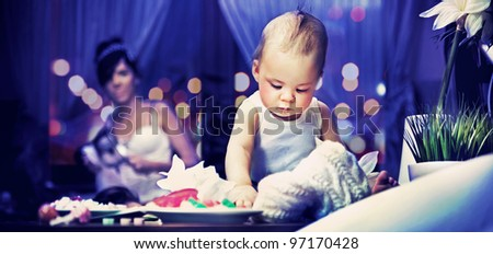 Cute child and mum in kitchen