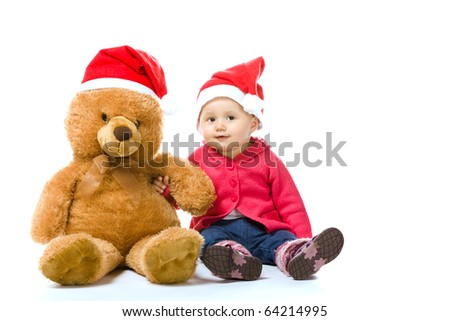 cute child and teddy bear with santa hat, isolated on white background - stock photo