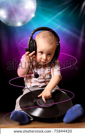 Cute child baby dj in disco - stock photo