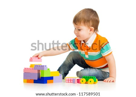 cute child boy with construction set over white background