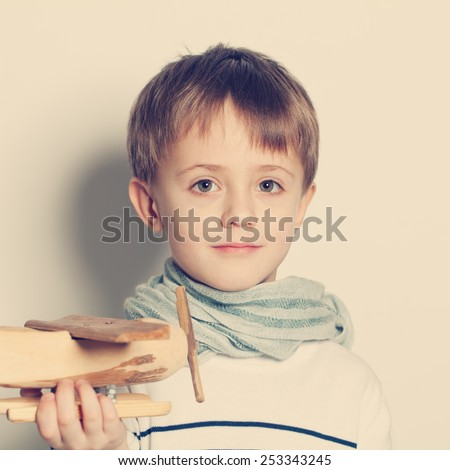 Cute child boy with toys, portrait - stock photo