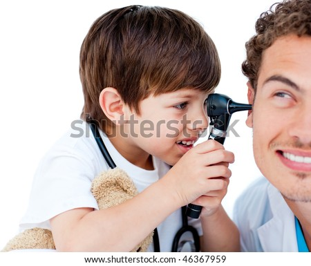 Cute child checking doctor's ears at the hospital