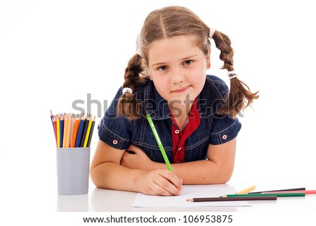 Cute child draw with colorful crayons and smile, isolated over white - stock photo