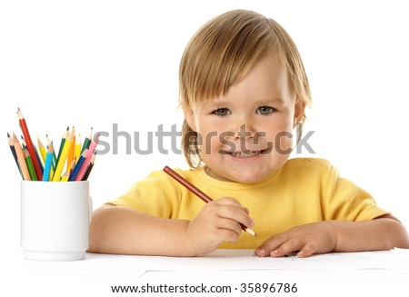 Cute child draw with crayons and smile, isolated over white - stock photo