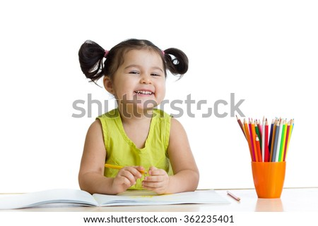 Cute child drawing with colorful crayons - stock photo