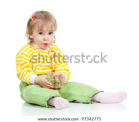 cute child drinking apple juice from glass with help of straw - stock photo