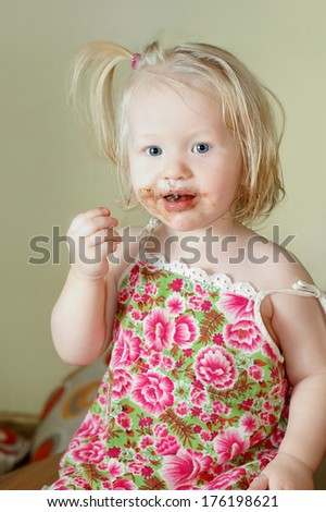 Cute child eating chocolate  - stock photo