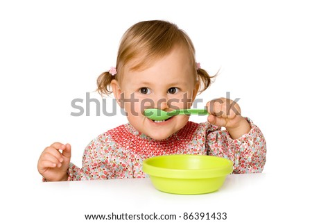 Cute child eating, isolated over white