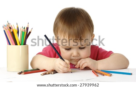 Cute child, focused, drawing on white paper, isolated - stock photo