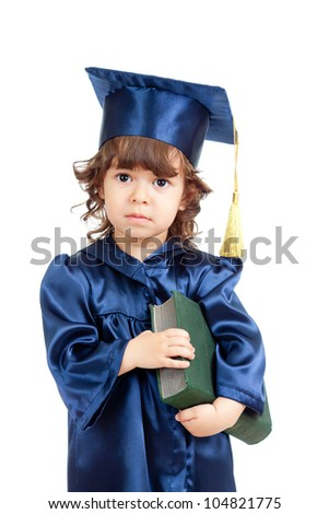 Cute child girl in academician clothes  with book