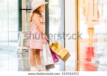 cute child girl in shopping mall