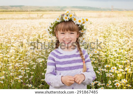 Cute child girl is resting on the nature