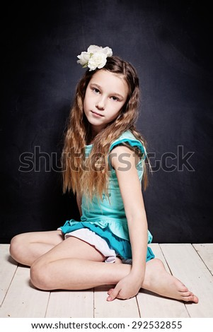Cute Child Girl. Portrait of Young Teen on Dark Background - stock photo