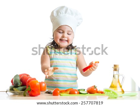 cute child girl preparing healthy food in the kitchen