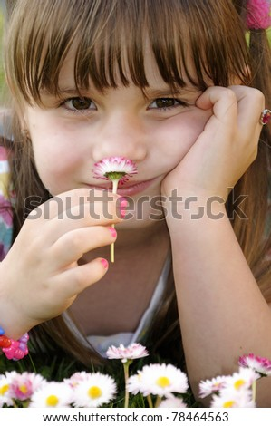Cute child girl's portrait in home garden - stock photo