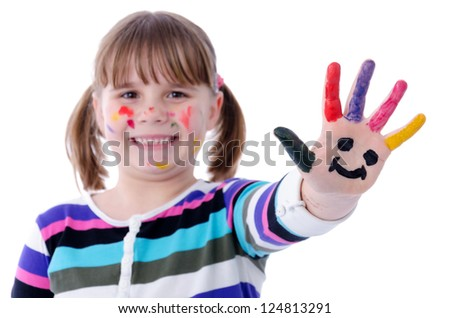 Cute child girl shows painted hand with smiley face - stock photo