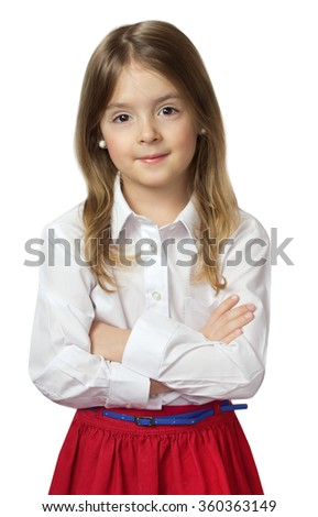 Cute child girl standing in white shirt & red skirt isolated on white. Toddler studio look at camera caucasian. - stock photo