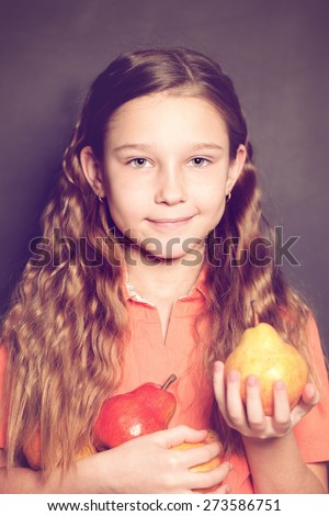 Cute Child Girl with pear fruit. Healthy Eating, food concept - stock photo