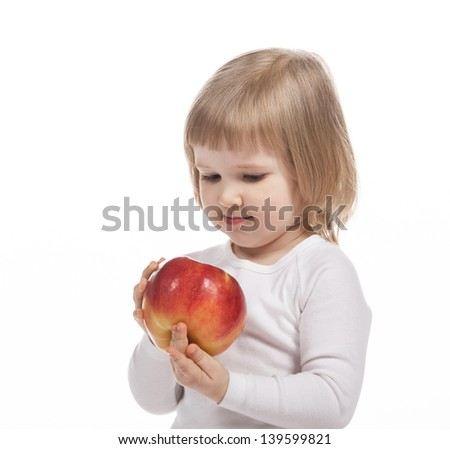 Cute child holding red apple on white background - stock photo