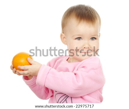 Cute child holds mandarin, isolated over white