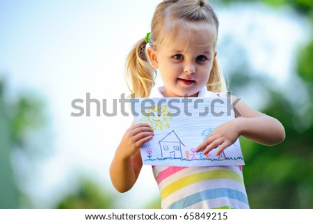 Cute child holds up drawing of a family - stock photo