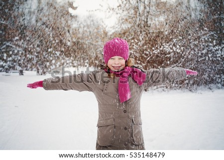 Cute Child in Snowy Winter Outdoors