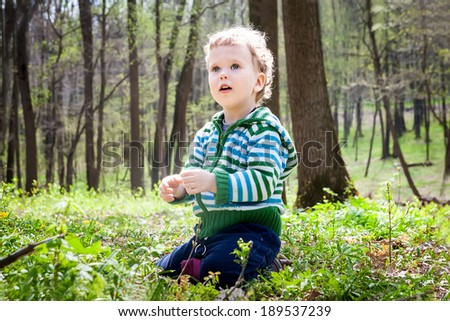 Cute child in the spring forest