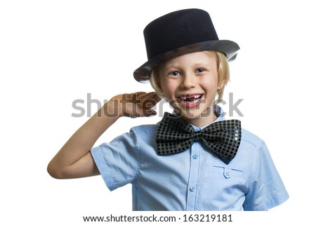 Cute child in top hat and bow tie with hand to ear. Isolated on white with copy-space. - stock photo