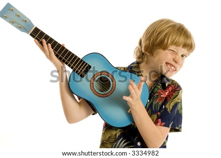 Cute child in tropical outfit playing guitar or ukelele - stock photo