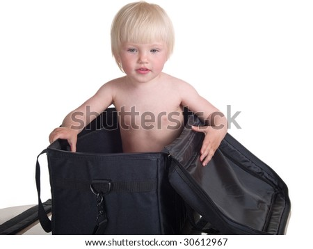 cute child into large bag