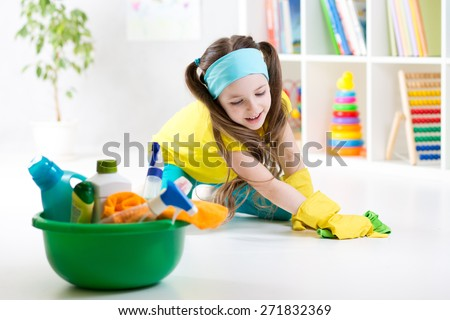 Cute child little girl cleanses a floor in nursery at home - stock photo