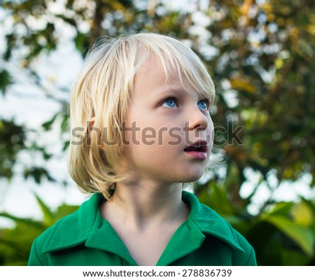 Cute child looking with wonder in nature - stock photo