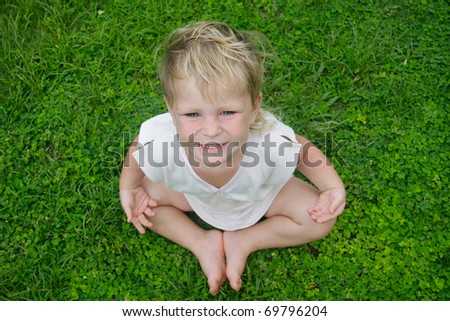 cute child meditating on natural background - stock photo