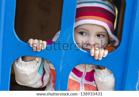 cute child playing at the playground - stock photo