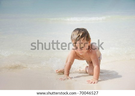 cute child playing on beach
