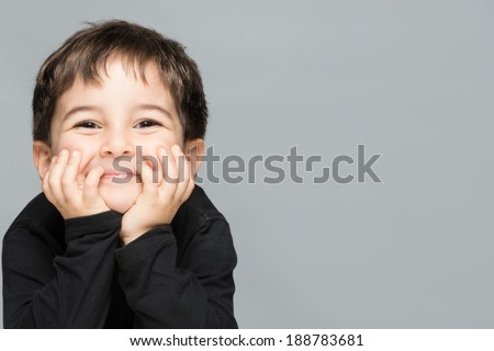 Cute child  positive and real smile - stock photo