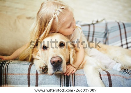 Cute child resting with dog - stock photo