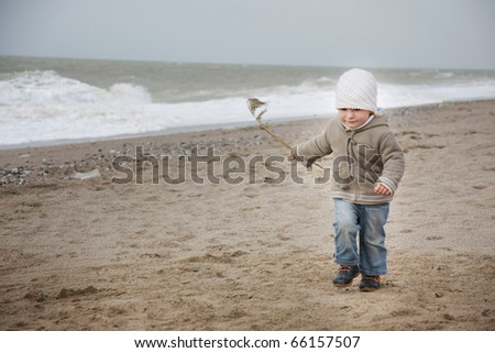 cute child running on beach - stock photo