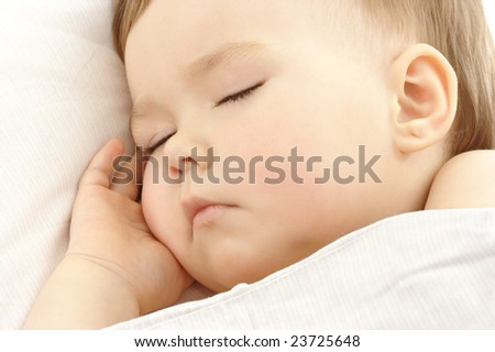 Cute child sleep with hand under his cheek, high key portered