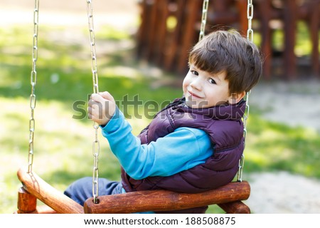 Cute child swing at outdoor, childhood - stock photo
