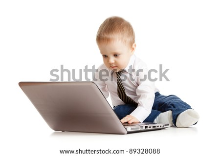 Cute child using laptop - stock photo